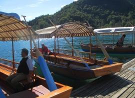Pletna boats docked below the church